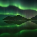 Northern lights dance and illuminate the arctic Lofoten shore (long exposure) - Norway