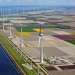 Huge windmills in a diked polder
