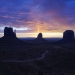 The Sun rising behind a Sandstone Butte in Monument Valley