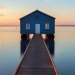 A boathouse during a sunrise